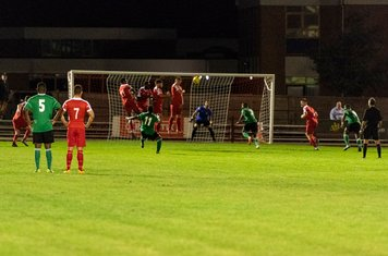 Hendon's free kick clears Borough's leaping wall