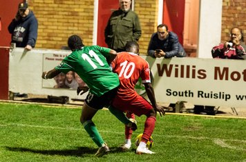...and Eric Sowanola battle to hang on to the ball in the last few minutes...