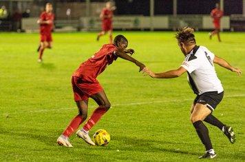 Samuel Olanrewaju is challenged by Wayne Cater