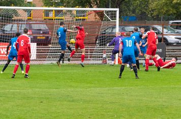 ...and in goal-scoring form, knocking Michael Bryan's corner into the net