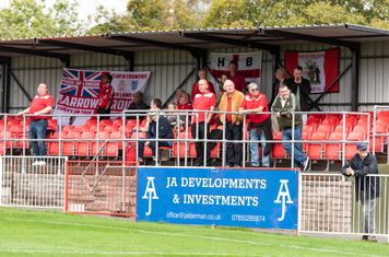 The Borough travelling supporters enjoy the first half sunshine