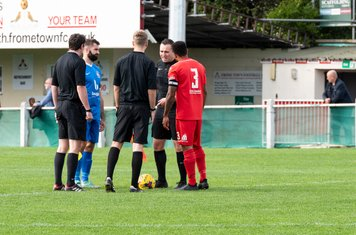 The Officials and captains Ryan Moss and Rickie Scott