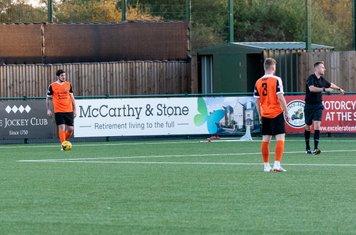 Jack Battie takes a free kick...
