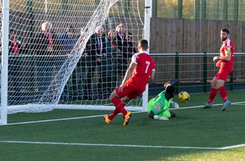 ...but Denzal Gerrar scrambles the ball clear