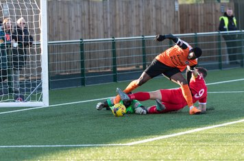 ...Ryan Moss tussles for the loose ball...