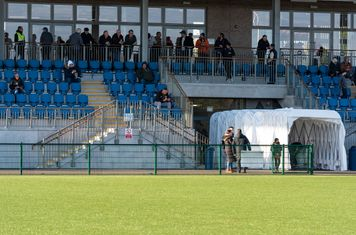 Some of the Borough faithful in the only covered standing wait for the teams to come out...