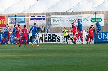 ...but it comes at the wrong end as Matthew Williams (no 6) heads Supermarine into an early lead from a corner