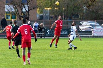 Shaun Preddie beats former Borough captain Marc Charles-Smith to the ball