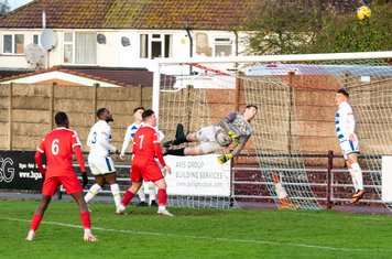 Liam Beach leaps to defend his goal