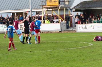 George Fenton tackles on the half way line...
