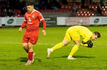 Luke Williams pips Dylan Kearney to the ball