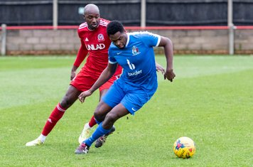 Nathaniel Oseni nips in to keep Marvin Morgan away from the ball
