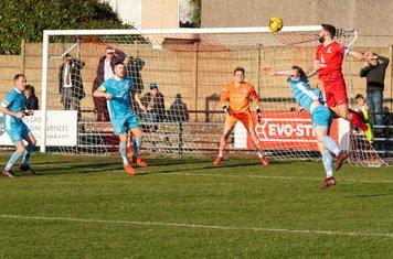 Ryan Moss heads for goal