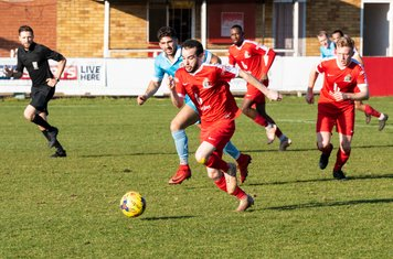 Michael Bryan comes out of defence at full speed