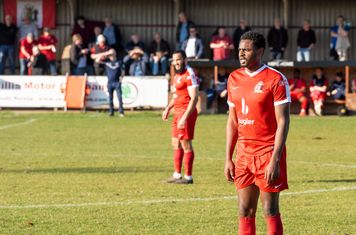 ...Nathaniel Oseni form a strong partnership at the back