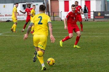 Pierce Mitchell runs at the Harrow defence