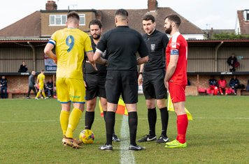 Captains Matt Wright and Ryan Moss and the Officials
