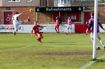 An acrobatic leap from Jordan Lee  as Wimborne are determined to hang on to their lead