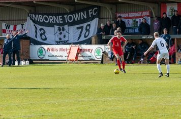 Jordan Ireland comes forward as the Wimborne bench give directions