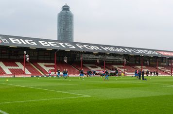 Harrow Borough warm up in the impressive surroundings of the soon to be replaced Griffin Park