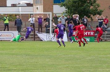 Hafed Al-Droubi saves as the Merthyr fans hold their heads