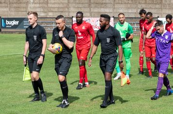 The Officials lead out the teams, with Adam Pepera captaining Borough