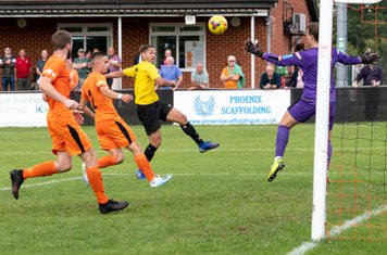 ...volleys the ball into the net