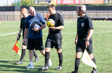 Manager Steve Conroy has a word with the Officials