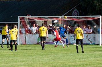 ...and Luke Holmes lobs Hafed Al-Droubi to make it 3 - 0 (88 mins)