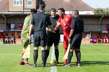 Captains Paris Hamilton-Downes and Shaun Preddie, and the Officials