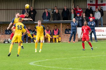 A strong Gosport defence deals confidently with Harrow's high balls...
