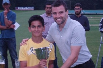 Krishan Kasuhal receiving the U12 Premier League Trophy from Ist Team Captain Andy Sutton