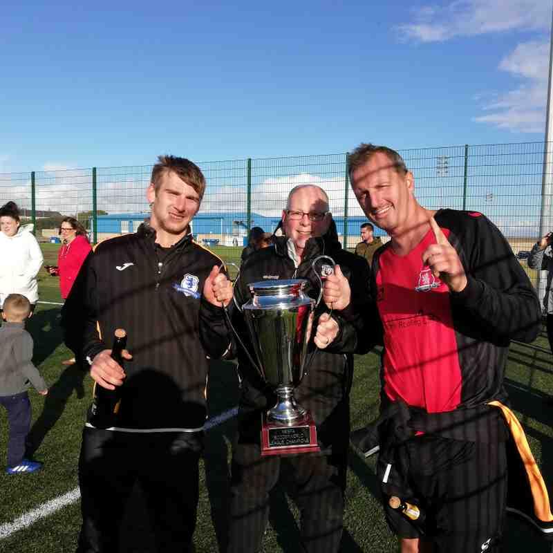 League Secretary presents League 2 Trophy to K Norris & E Mcleman