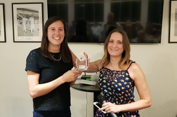 Emily Kirby-Jones receiving her Womens XI Player of the Year from Lucy Trott