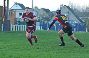 Larne Patrick heads for the line
