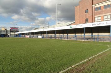 Macclesfield Road end, pitch side.