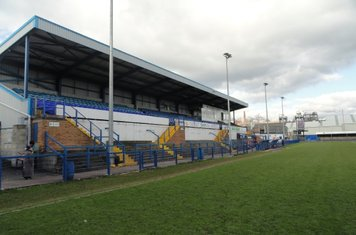 Main stand, pitch side.