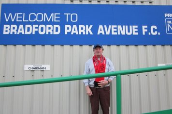 14/01/2013 – Bill Brazier wearing his Shirebrook Town FC scarf and pictured recently inside the Horsfall Stadium, the home of Bradford Park Avenue and Albion Sports.