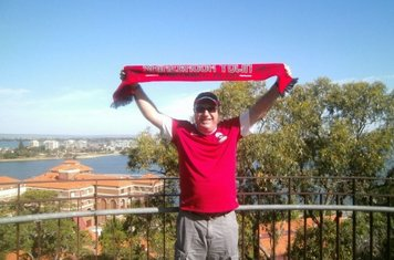 14/01/2013 – 'Brookie on Tour' Ian Oxley holding his Shirebrook Town FC scarf high for all to see in front of the magnificent backdrop from King Park in Perth, Western Australia. The photo was taken Christmas 2012.