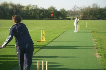 Lydia bowls the first ball