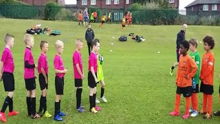 LS27 FC Under 9 Pinks 'Respect' handshake with Chapeltown FYDC