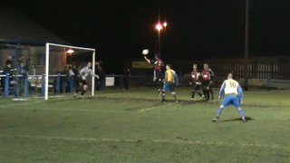 Chris Ridehalgh scores his first goal for Town and gets buried in the process under a sea of bodies