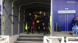 Mascots from Brandon Groves AFC lead out the teams
