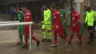 Players enter pitch